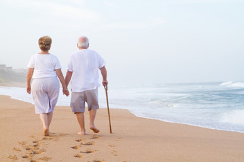 Elderly couple strolling at beach